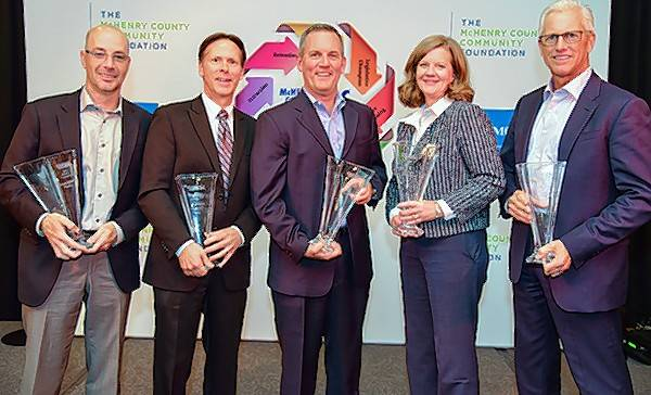 The 2016 Business Champion Award winners, from left, Keith Wagner, Fabric Molded Plastics; Gary Reece, Heartland Cabinet Supply; Robert Jessup, Jessup Manufacturing; Jill Dinsmore, JA Frate Companies; and Michael Eesley, Centegra.