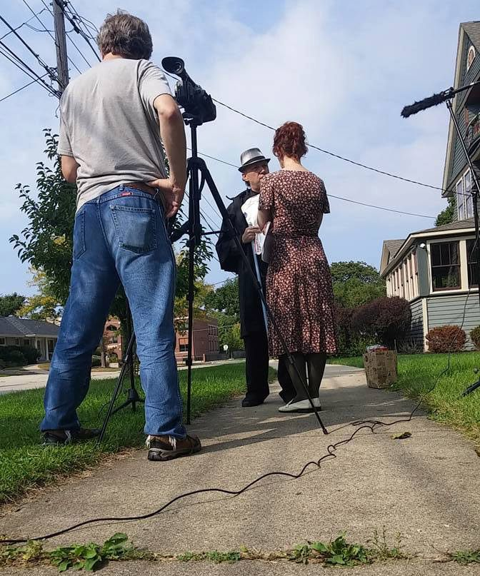"Co-director Jeff Kelley films a scene in Elgin for the short ""The Devil Cat"" with actors Jason Pawlowski and Valerie Meachum. It will be shown this week at Nightmare on Chicago Street."