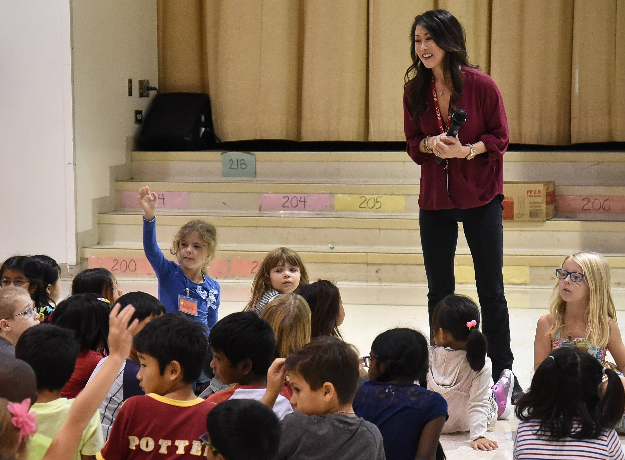 "Olympic champion Kristi Yamaguchi read her latest children's book, ""Cara's Kindness"" to students Tuesday at Frank C. Whiteley School in Hoffman Estates."