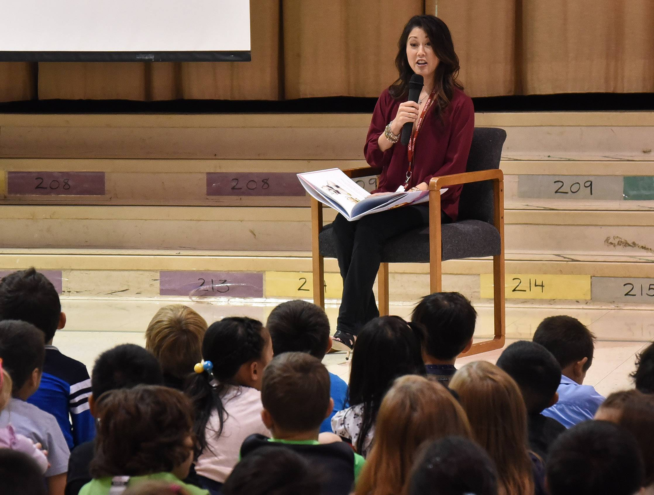 "Figure skater Kristi Yamaguchi read to students Tuesday at Frank C. Whiteley School in Hoffman Estates. Proceeds from the book, ""Cara's Kindness"" benefit early childhood literacy efforts."
