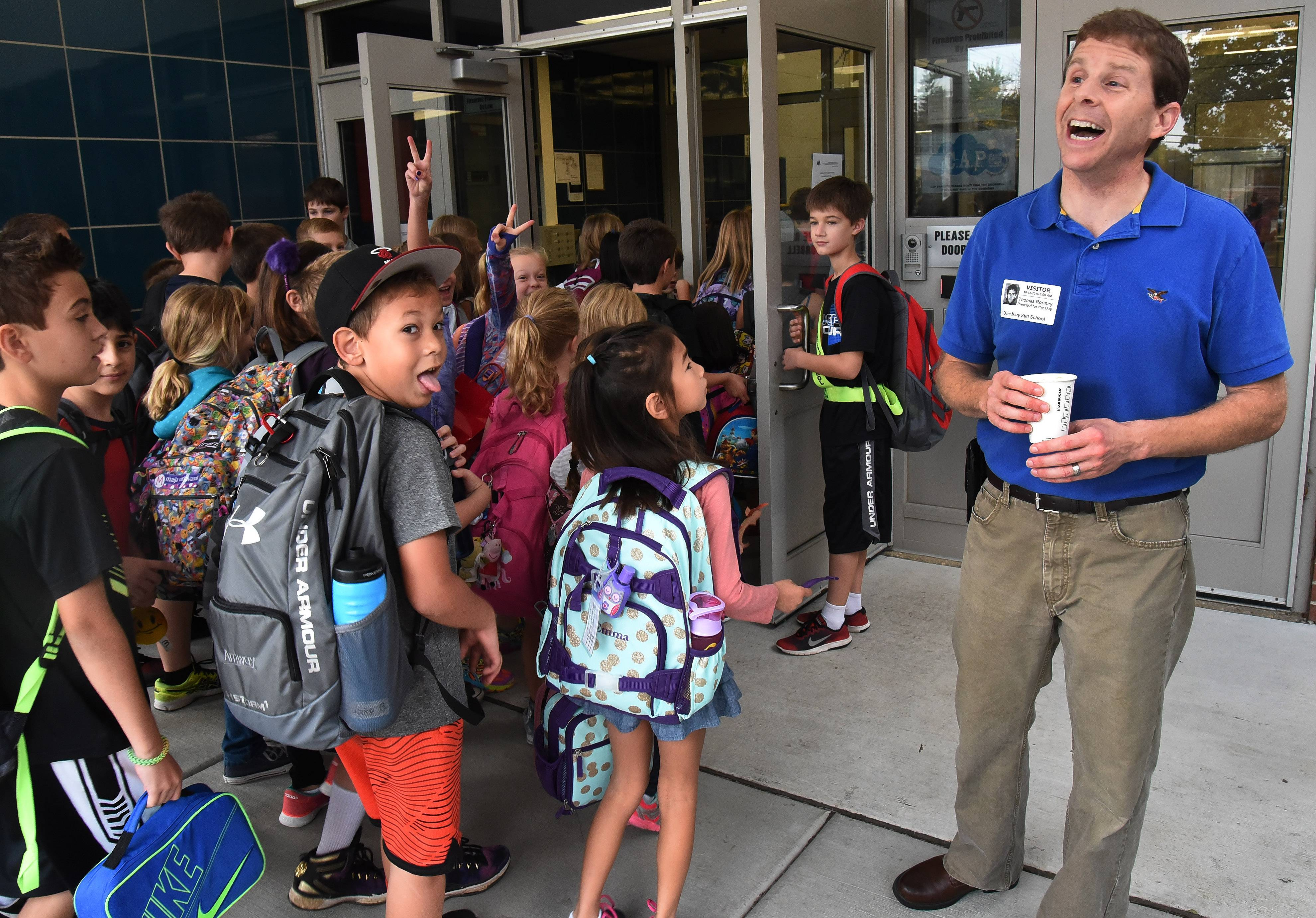 State Sen. Tom Rooney welcomes students arriving Tuesday morning at Olive-Mary Stitt Elementary School in Arlington Heights.