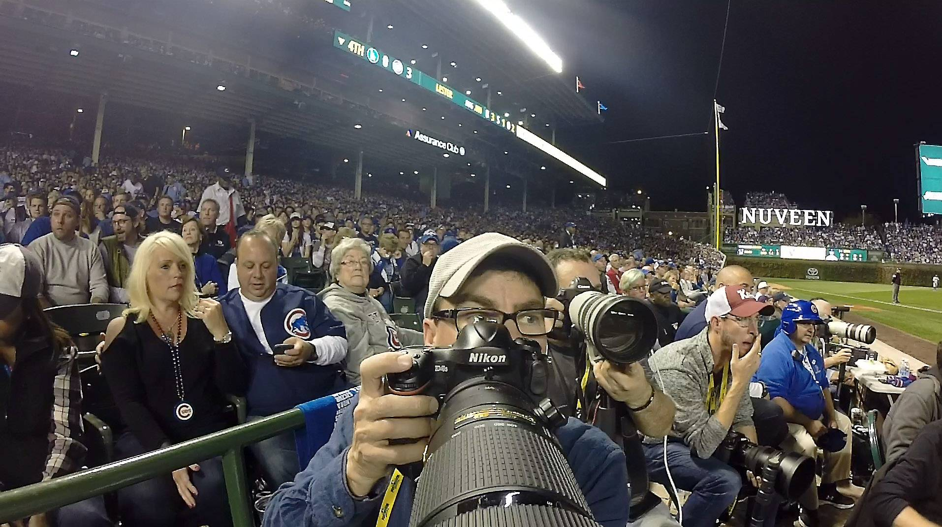 A look at Daily Herald photographer John Starks as he gets ready to shoot a picture during the National League championship series at Wrigley Field.