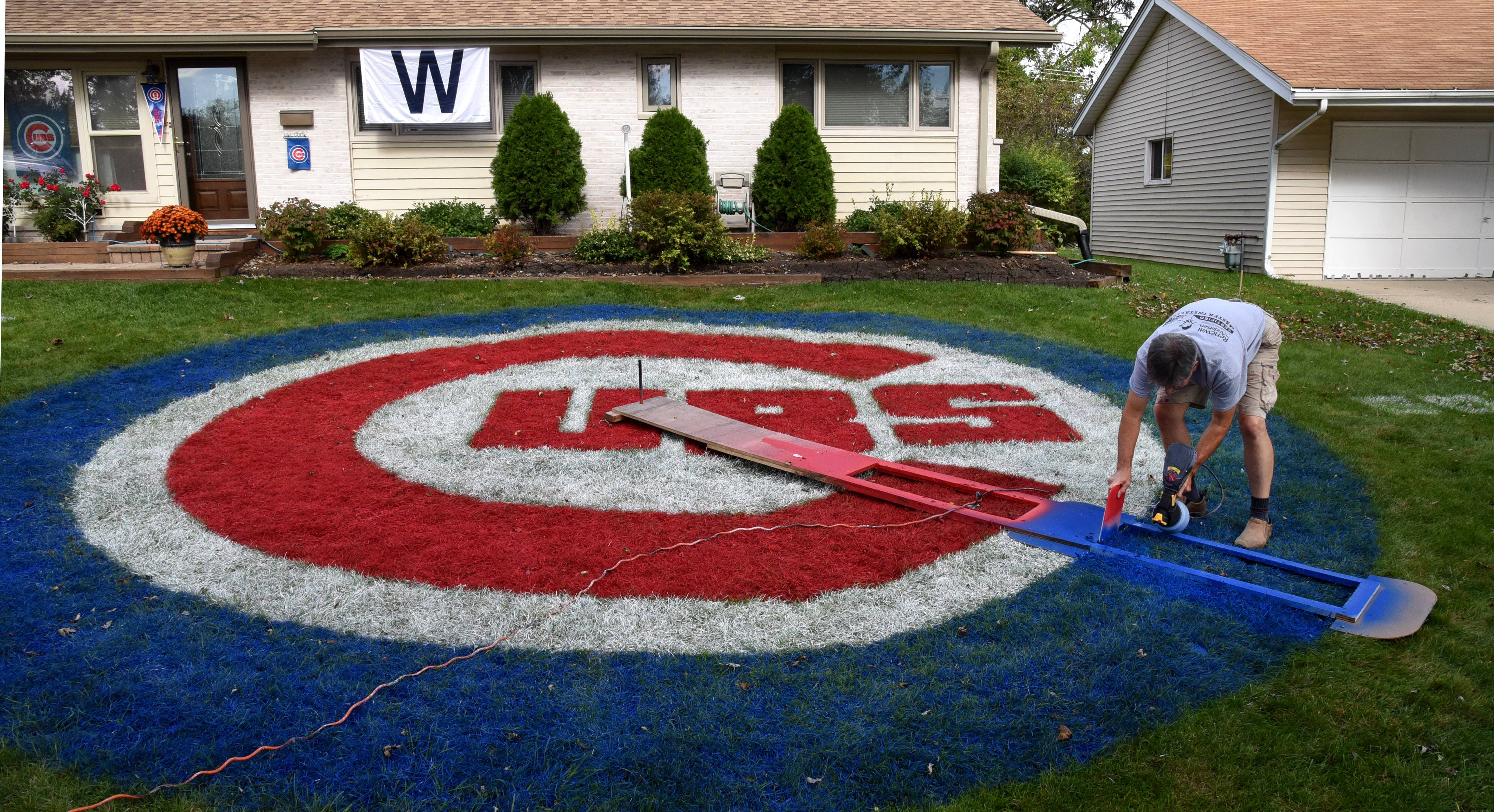Jim McNamara of Hoffman Estates is showing his support for the Cubs with a 27-foot-diameter team logo he's painted on his front lawn. From the reactions he's getting from passing drivers, it's easy to tell who's a Cubs fan and who's a White Sox fan.
