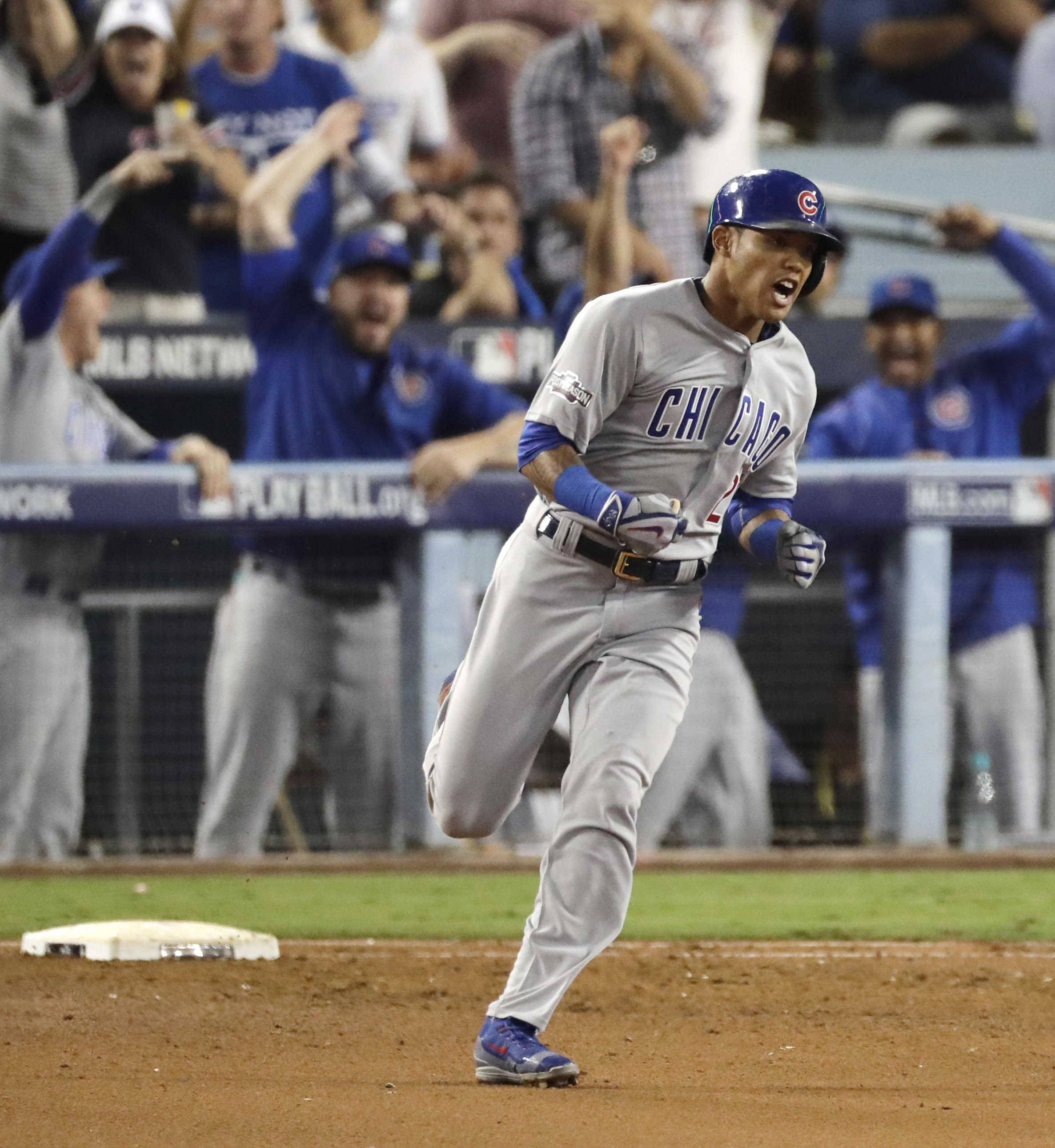 Chicago Cubs' Addison Russell reacts after hitting a two-run home run during the fourth inning of Game 4 of the National League baseball championship series against the Los Angeles Dodgers Wednesday, Oct. 19, 2016, in Los Angeles.