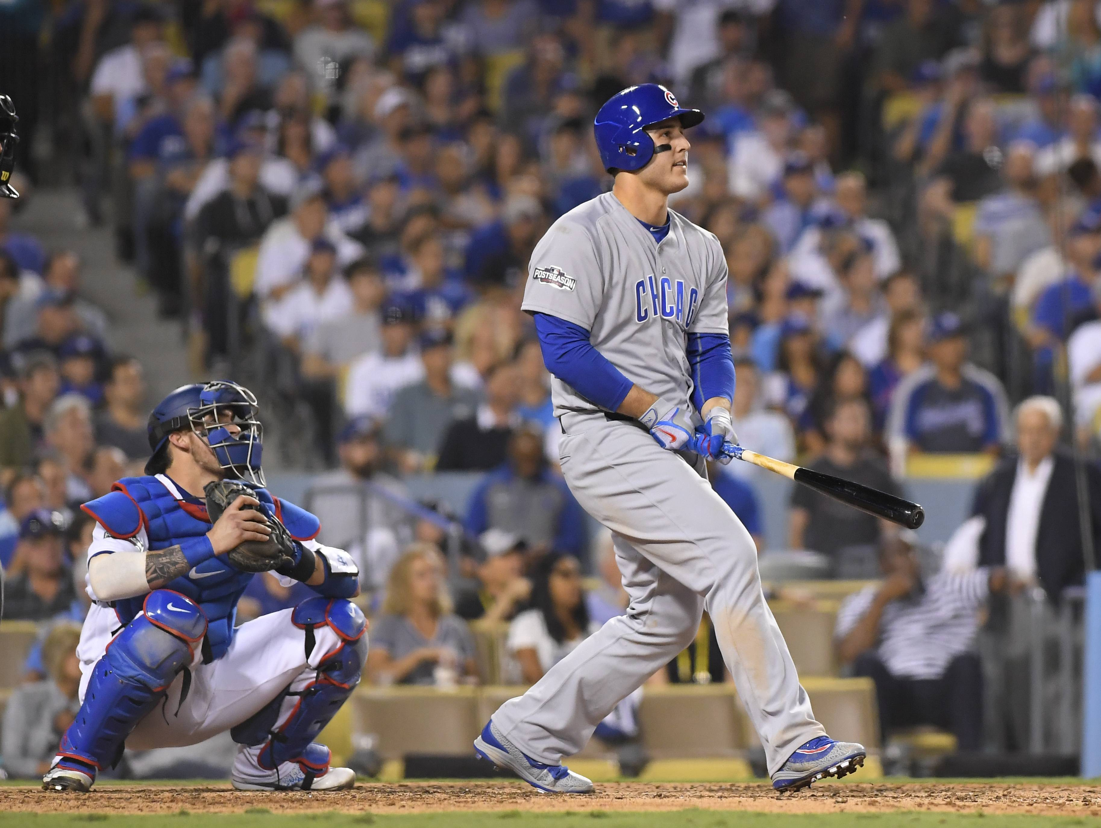 The Chicago Cubs' Anthony Rizzo hits a home run during the fifth inning of Game 4 of the National League championship series against the Los Angeles Dodgers Wednesday in Los Angeles.