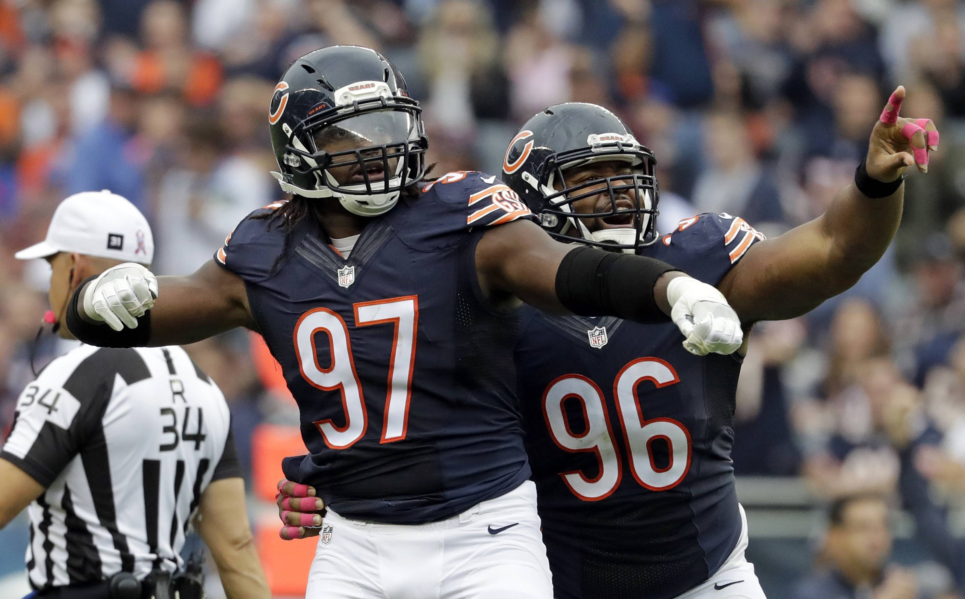 Chicago Bears outside linebacker Willie Young (97) and defensive end Akiem Hicks (96) celebrates a sack against the Jacksonville Jaguars during the first half of an NFL football game in Chicago, Sunday, Oct. 16, 2016.