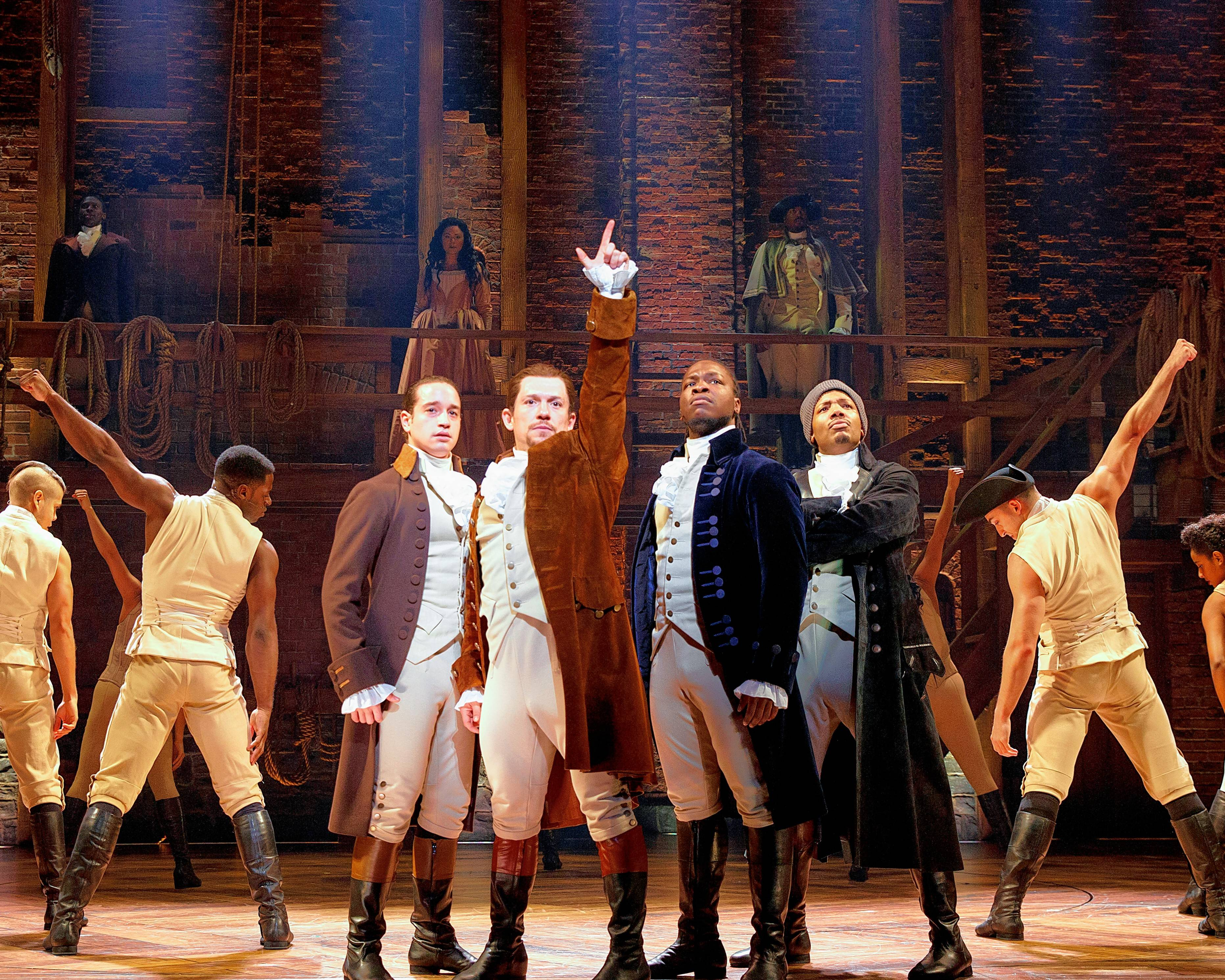 "Alexander Hamilton (Miguel Cervantes), second from left, prepares for revolution along with John Laurens (Jose Ramos), left, Aaron Burr (Joshua Henry), second from right, and Hercules Mulligan (Wallace Smith) in the Chicago production of ""Hamilton."""