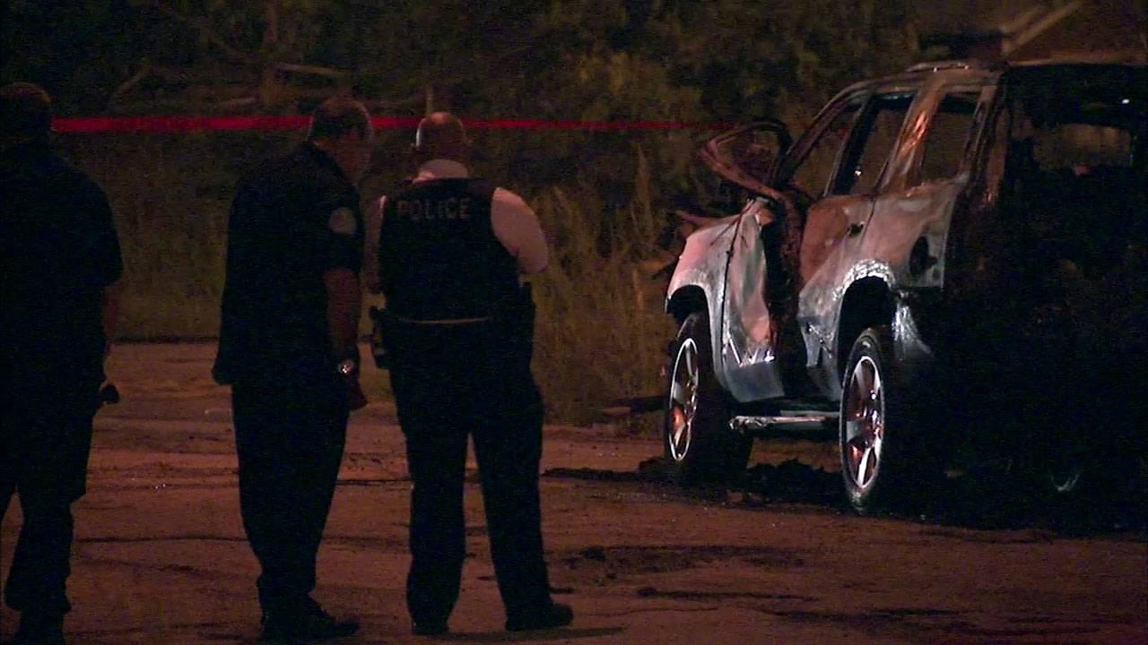 Officials: Man found in burning car was beaten to death