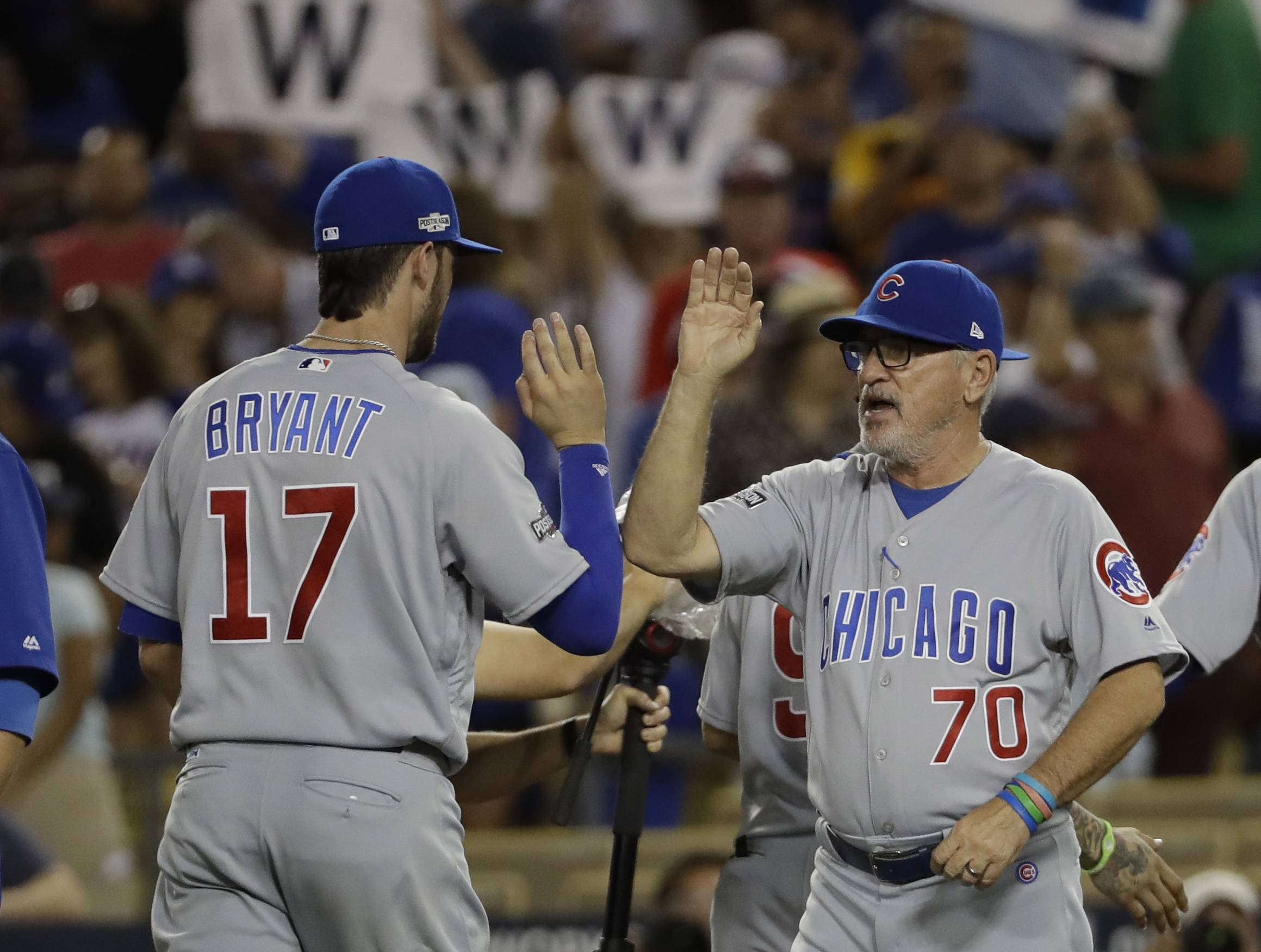 Chicago Cubs manager Joe Maddon celebrates with Kris Bryant after Game 5 of the National League baseball championship series against the Los Angeles Dodgers Thursday, Oct. 20, 2016, in Los Angeles. The Cubs won 8-4 to take a 3-2 lead in the series. (AP Photo/David J. Phillip)