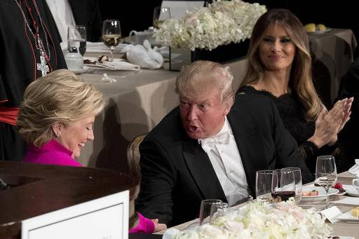 Republican presidential candidate Donald Trump, center, accompanied by his wife Melania Trump, right, shakes hands with Democratic presidential candidate Hillary Clinton, left, after they both speak at the 71st annual Alfred E. Smith Memorial Foundation Dinner, a charity gala organized by the Archdiocese of New York, Thursday, Oct. 20, 2016, at the Waldorf Astoria hotel in New York. (AP Photo/Andrew Harnik)