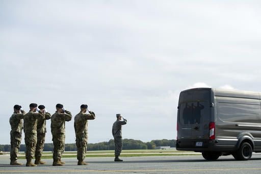 An Army carry team salutes as the remains of Army Sgt. Douglas Riney, 26, of Fairview, Ill., leave the flight line in a transfer vehicle, Friday, Oct. 21, 2016, at Dover Air Force Base, Del. According to the Defense Department, Riney died Oct. 19 in Kabul, Afghanistan, of wounds received from encountering hostile enemy forces while supporting Operation Freedom's Sentinel.
