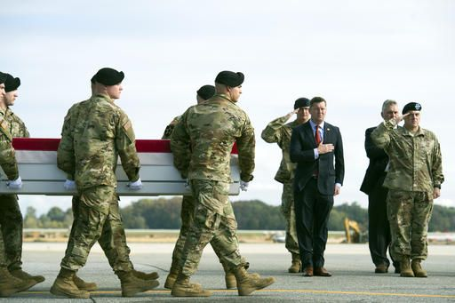 An Army carry team moves a transfer case containing the remains of Army Sgt. Douglas Riney, 26, of Fairview, Ill., past Army Secretary Army Eric Fanning, center, and Army Chief of Staff Gen. Mark Milley, right, Friday, Oct. 21, 2016. at Dover Air Force Base, Del. According to the Defense Department, Riney died Oct. 19 in Kabul, Afghanistan, of wounds received from encountering hostile enemy forces while supporting Operation Freedom's Sentinel.