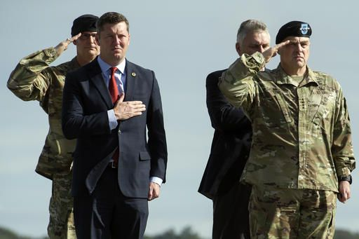 Army Secretary Eric Fanning, left, and Army Chief of Staff Gen. Mark Milley, right, salute during a Dignified Transfer Ceremony for Army Sgt. Douglas Riney, 26, of Fairview, Ill., Friday, Oct. 21, 2016. at Dover Air Force Base, Del. According to the Defense Department, Riney died Oct. 19 in Kabul, Afghanistan, of wounds received from encountering hostile enemy forces while supporting Operation Freedom's Sentinel.