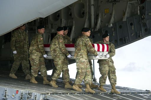 An Army carry team moves a transfer case containing the remains of Army Sgt. Douglas Riney, 26, of Fairview, Ill., Friday, Oct. 21, 2016. at Dover Air Force Base, Del. According to the Defense Department, Riney died Oct. 19 in Kabul, Afghanistan, of wounds received from encountering hostile enemy forces while supporting Operation Freedom's Sentinel.