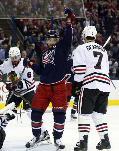 Columbus Blue Jackets' Nick Foligno, center, celebrates his goal against the Chicago Blackhawks during the second period of an NHL hockey game Friday, Oct. 21, 2016, in Columbus, Ohio. (AP Photo/Jay LaPrete)