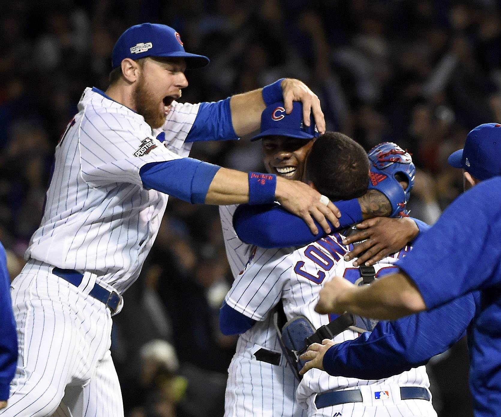 Chicago Cubs second baseman Ben Zobrist (18) and Willson Contreras celebrate after Game 6 of baseball's National League championship series, Oct, 22 2016, at Wrigley Field in Chicago.