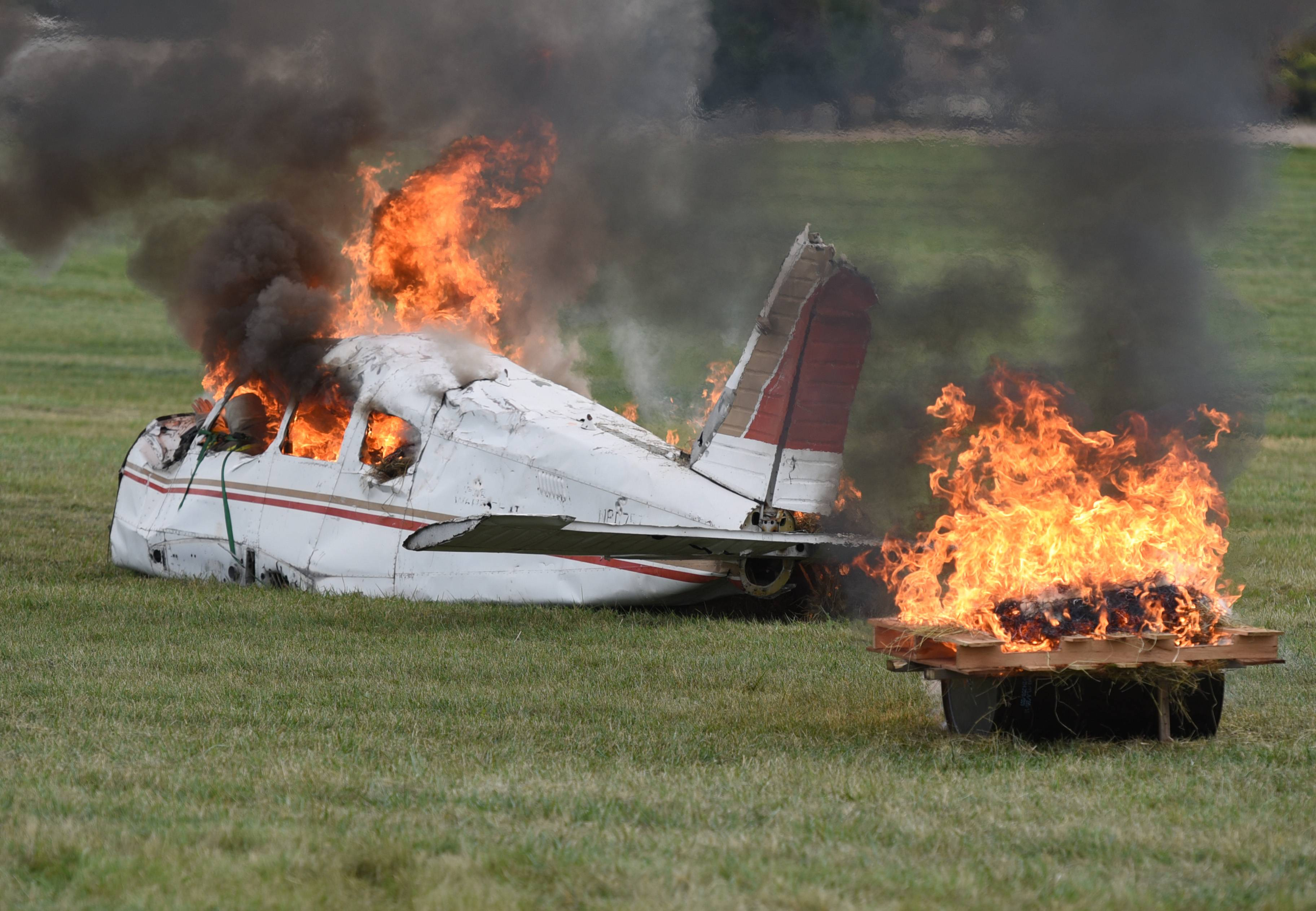 Part of a small plane served as the cockpit Saturday during a mock plane crash at DuPage Airport in West Chicago.