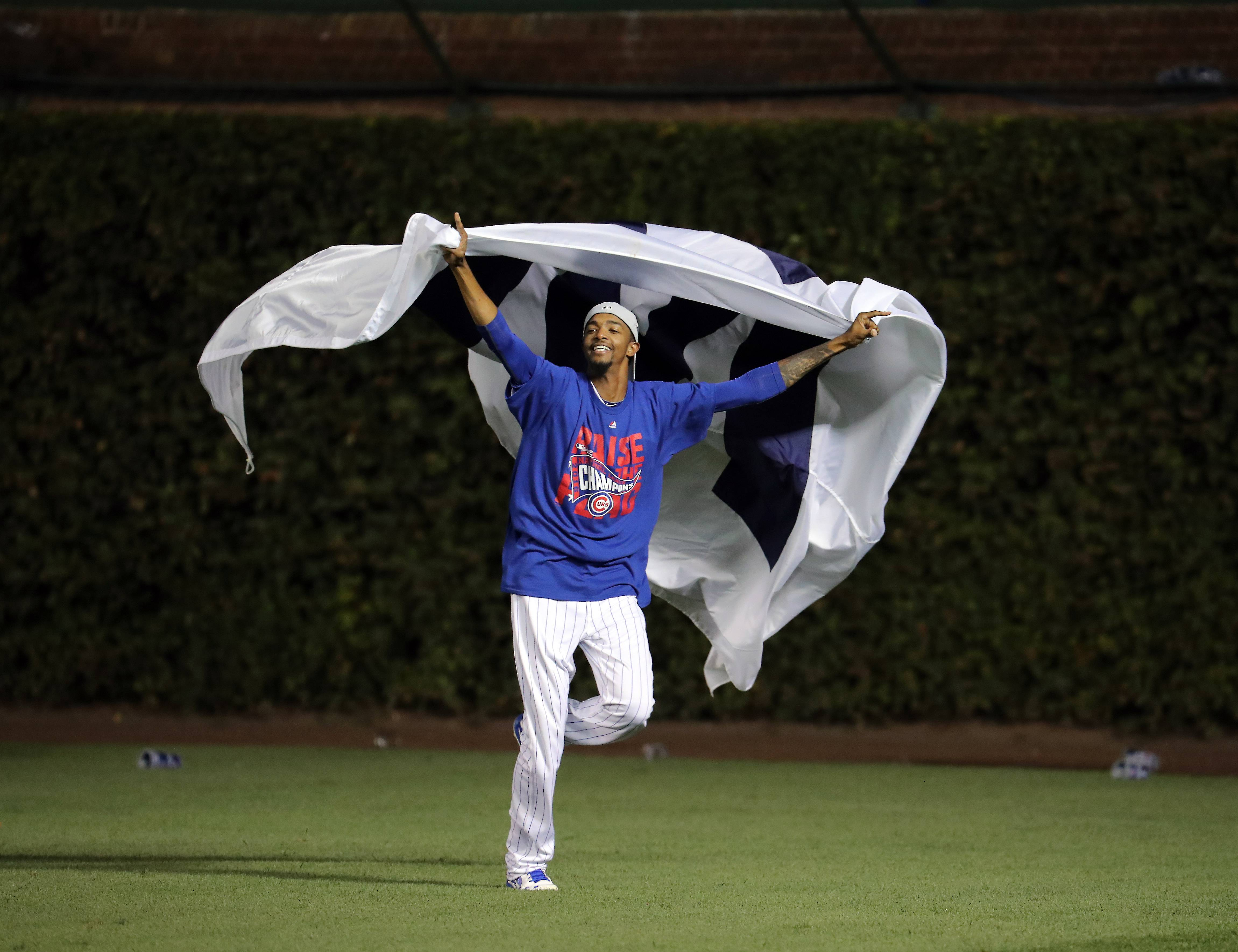 Chicago Cubs relief pitcher Carl Edwards (6) celebrates after Game 6 of baseball's National League championship series, Oct, 22 2016, at Wrigley Field in Chicago.