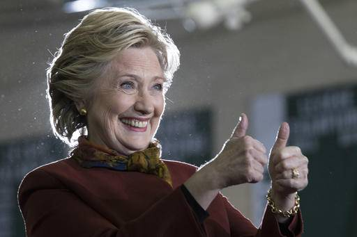 Democratic presidential candidate Hillary Clinton gestures at supporters during a campaign event at the Taylor Allderdice High School, Saturday, Oct. 22, 2016, in Pittsburgh, Pa. (AP Photo/Mary Altaffer)