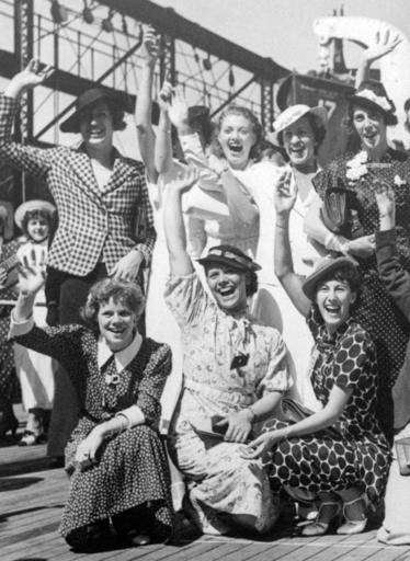 FILE - In this July 15, 1936, file photo, Simone Schaller, lower right, waves with members of the United States women's Olympic track and field team as they depart for Europe on the SS Manhattan. Schaller, an American hurdler who competed at the 1932 and 1936 Summer Games and was believed to be the oldest living Olympian, died of natural causes Thursday, Oct. 20, 2016, in the Arcadia, Calif., home she and her husband built when they married in the 1930s, her grandson Jeffrey Hardy said, Saturday, Oct. 22, 2016. She was 104. (AP Photo/File)