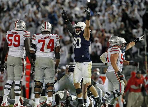 Penn State's Garrett Sickels (90) celebrates after a fourth-down sack of Ohio State quarterback J.T. Barrett during the second half of an NCAA college football game in State College, Pa., Saturday, Oct. 22, 2016. Penn State won 24-21. (AP Photo/Chris Knight)