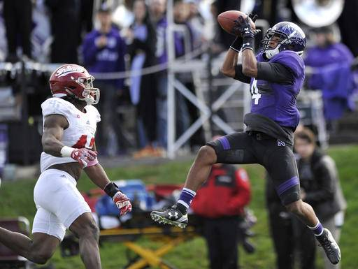 Northwestern wide receiver Solomon Vault (4) catches a touchdown pass against Indiana defensive back Marcelino Ball (42) during the first quarter of football game Saturday, Oct. 22, 2016, in Evanston, Ill. (AP Photo/Paul Beaty)