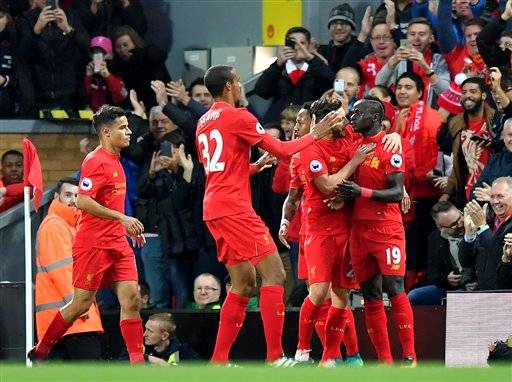 Liverpool's Sadio Mane, right, celebrates scoring his side's first goal of the game during the English Premier League soccer match between Liverpool and West Bromwich Albion at Anfield stadium, Liverpool, England, Saturday, Oct. 22, 2016. (Dave Howarth/PA via AP)