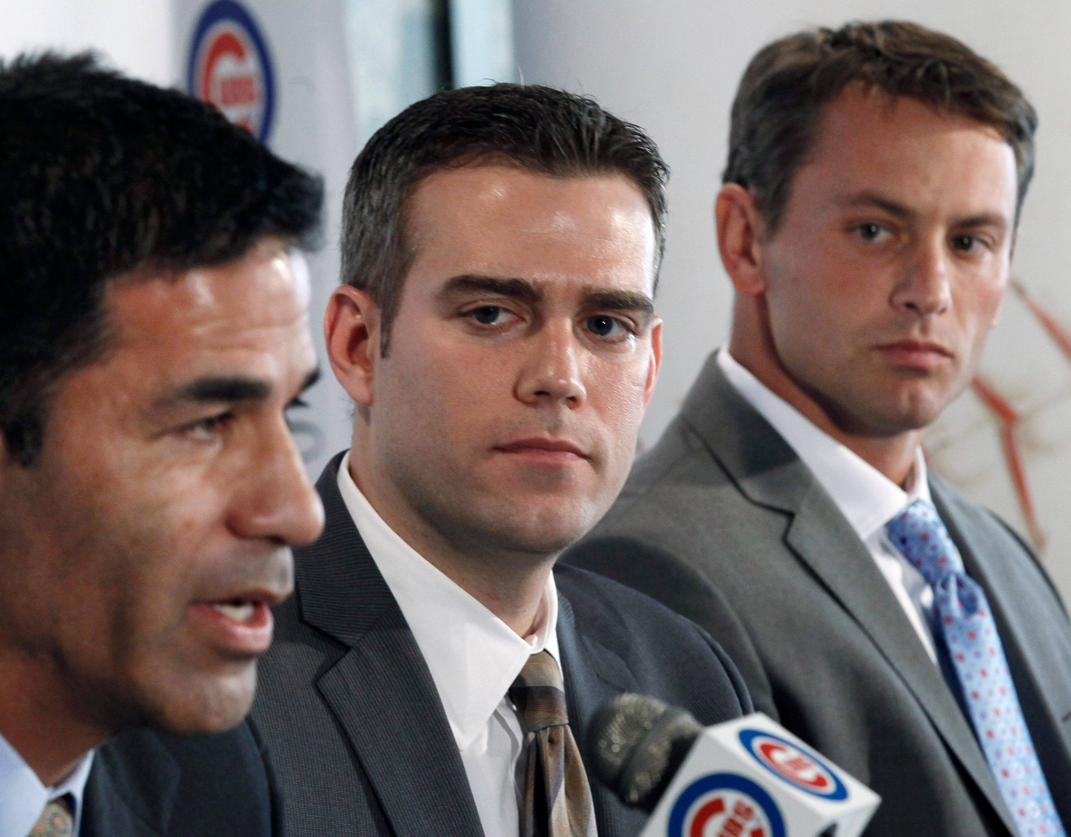 Chicago Cubs president of baseball operations Theo Epstein, center, and new general manager Jed Hoyer, right, listen to new head of scouting and player development Jason McLeod, during a news conference Tuesday, Nov. 1, 2011, in Chicago. Hoyer and McLeod are reuniting with Epstein, who also worked with the pair in Boston. (AP Photo/Charles Rex Arbogast)