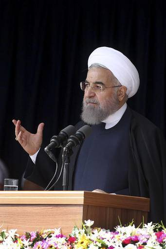"In this photo released by official website of the office of the Iranian Presidency, President Hassan Rouhani speaks to the crowd during a visit to the central city of Arak, Iran, Sunday, Oct. 23, 2016. Iran's president Hassan Rouhani criticized the U.S. presidential candidates' behavior during their debates. Rouhani said on Sunday: ""Did you see the debate and the way of their speaking, accusing and mocking each other? Do we want such a democracy and election in our country?"" (Iranian Presidency Office via AP)"