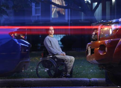 "In this Thursday, Oct. 13, 2016 photo, vehicles pass by as Jonathan Annicks poses for a portrait in front of his home, just a few feet from where a gunman shot him while he was inside his brother's parked car in Chicago on April 10. He has little interest in the shooter. ""If I lived with spite every day, then I don't think I would be able to function properly,"" he says. ""I'd be very miserable if I were worrying about what he's doing or where he is. I don't think it's worth it."" (AP Photo/Charles Rex Arbogast)"
