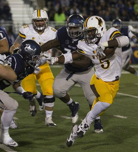 Wyoming running back Brian Hill runs against Nevada in the first half of an NCAA college football game in Reno, Nev., Saturday, Oct. 22, 2016. (AP Photo/Tom R. Smedes)