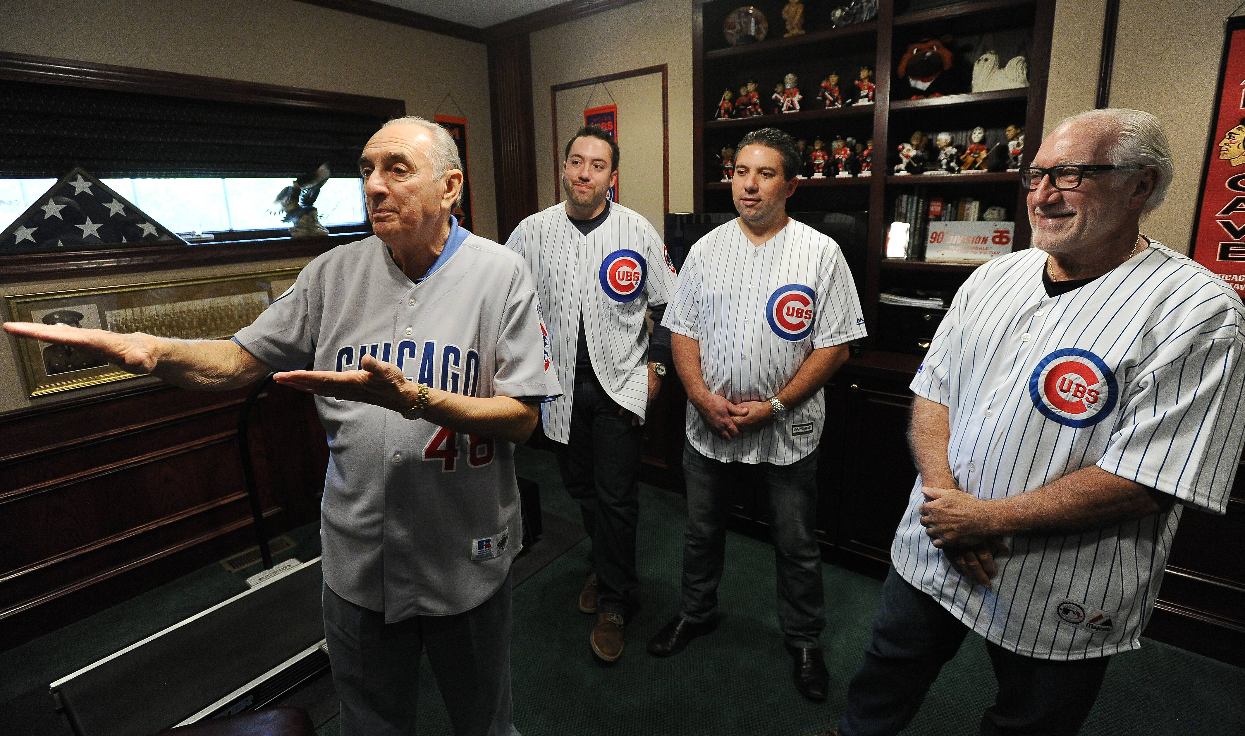 Telling stories about watching the 1945 World Series in Wrigley Field, 80-year-old Dan Pellettiere, left, of Palatine, will go to Saturday's game with his nephew, John Pellettiere Jr., right, and John's sons, John III and Joe.