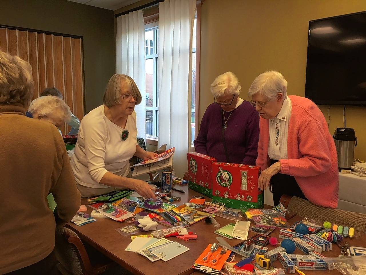 Sally Stemwedel, Mary Ann Parker and Gloria Mackley, residents of Covenant Village of Northbrook, pack boxes for Operation Christmas Child last year.