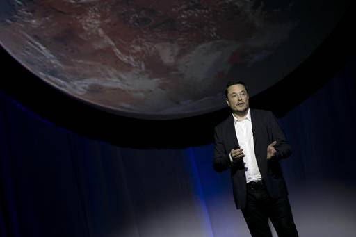 FILE - In this Sept. 27, 2016, file photo, SpaceX founder Elon Musk speaks during the 67th International Astronautical Congress in Guadalajara, Mexico. Musk elaborated on his plans to colonize Mars in a Reddit session Sunday, Oct. 23, 2016. (AP Photo/Refugio Ruiz, File)
