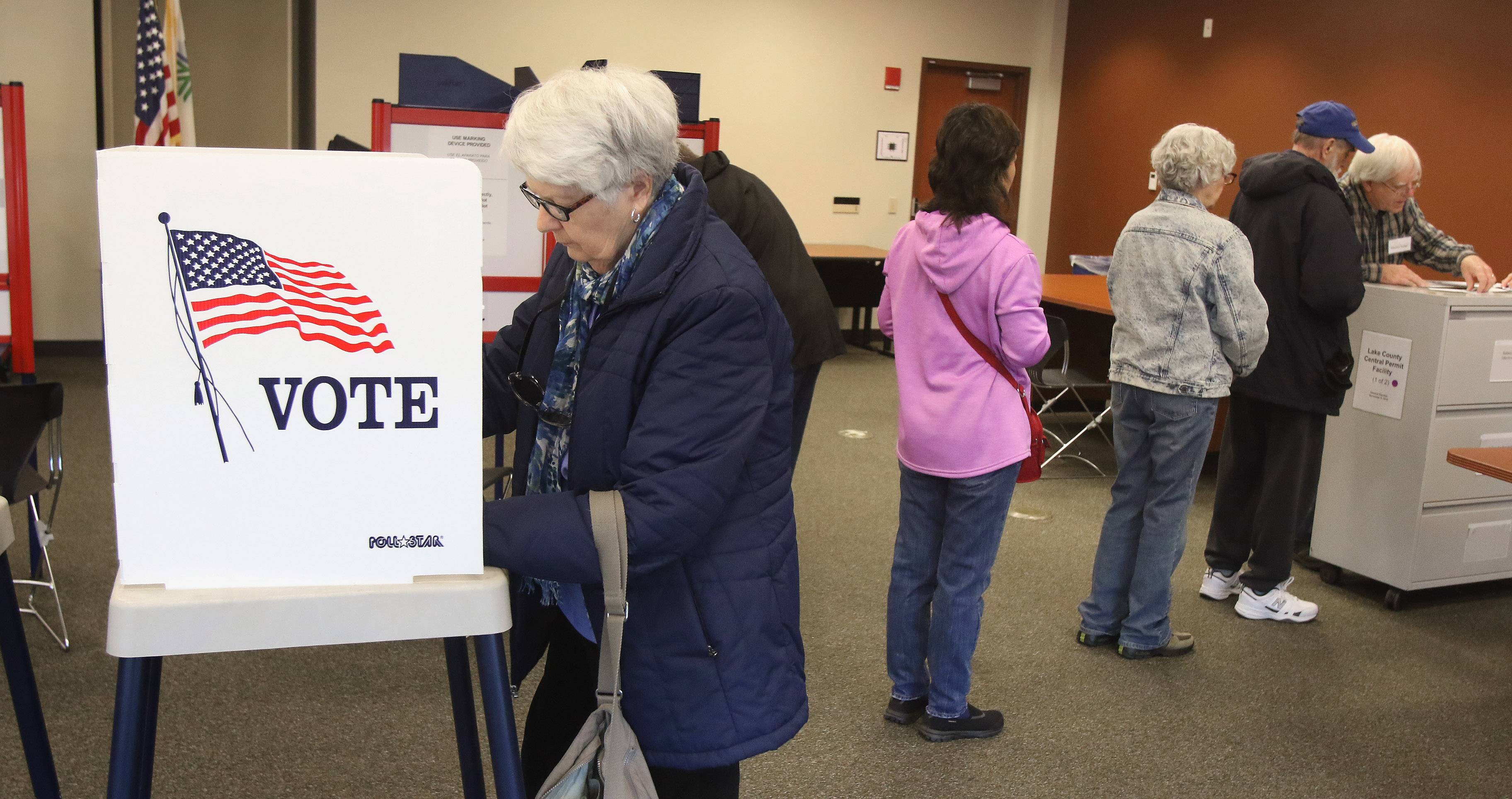 Maureen Watier of Libertyville votes Tuesday at the Lake County Central Permit Facility in Libertyville. Early voting began Monday at 14 sites across the county and continues through Nov. 7.