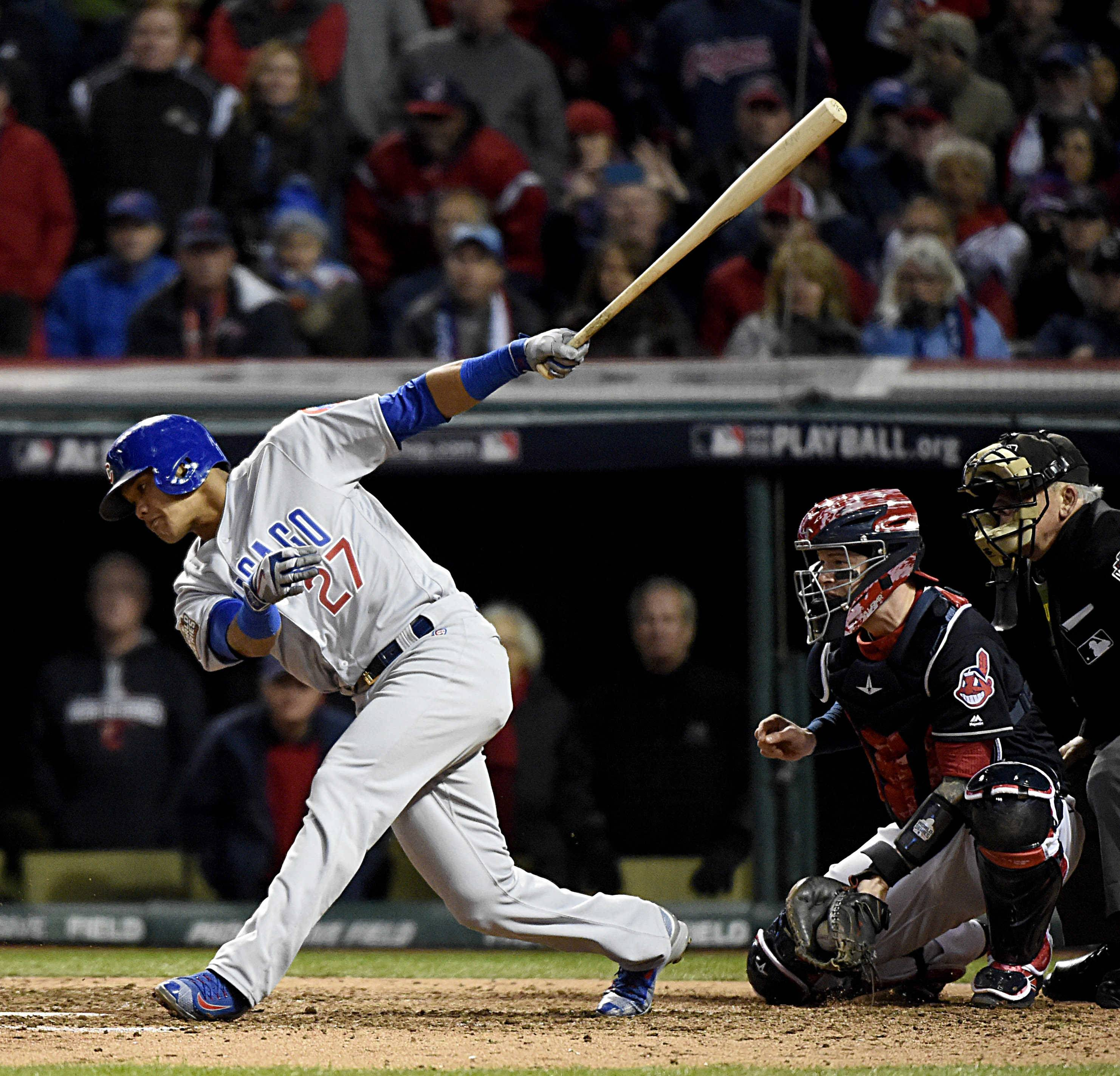 Chicago Cubs shortstop Addison Russell (27) comes up empty on a swing for strike three in the seventh inning during Game 1 of the Major League Baseball World Series between the Cleveland Indians and the Chicago Cubs Tuesday, Oct. 25, 2016, in Cleveland.