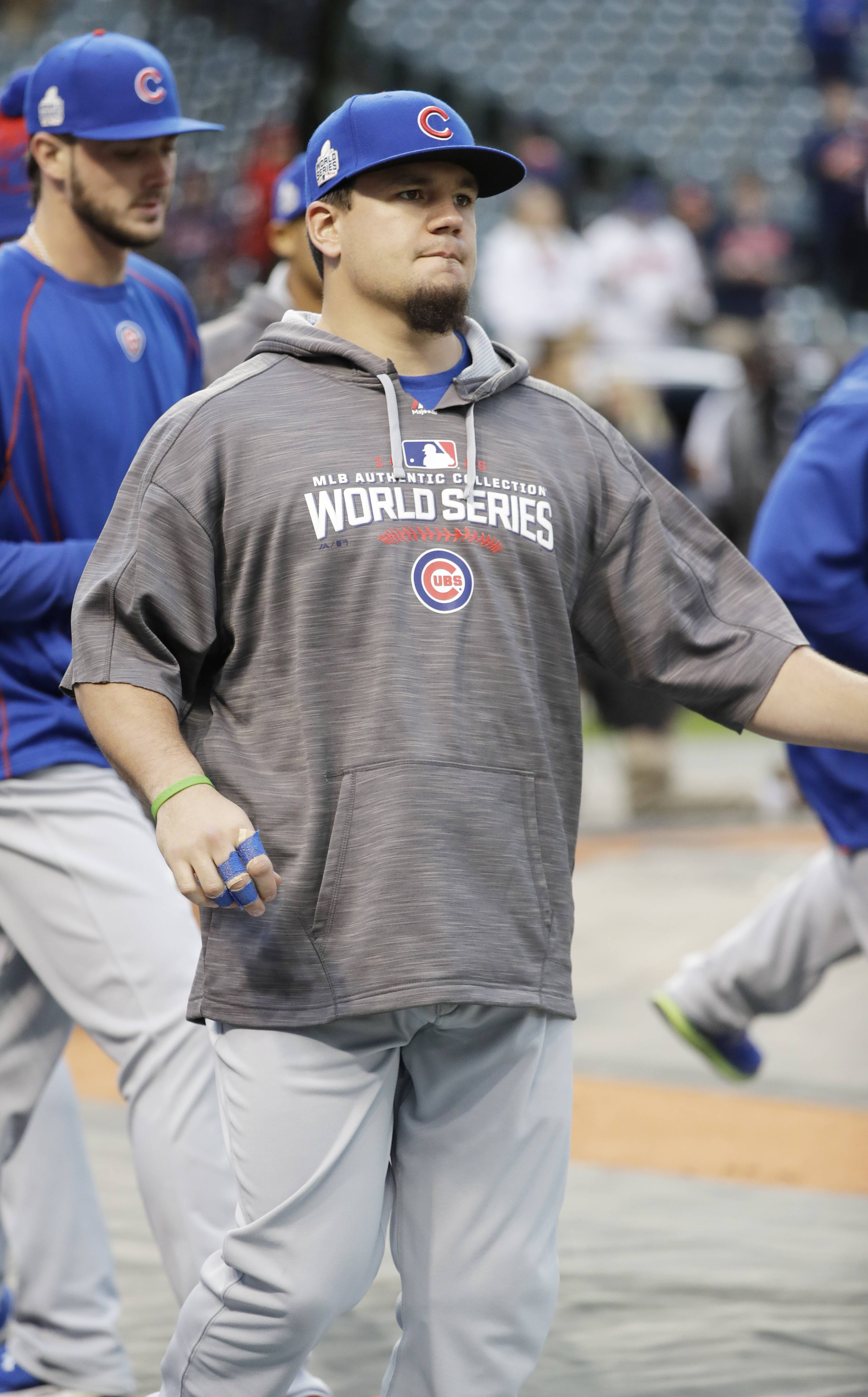 Chicago Cubs' Kyle Schwarber watches batting practice before Game 1 of the Major League Baseball World Series against the Cleveland Indians Tuesday, Oct. 25, 2016, in Cleveland. (AP Photo/David J. Phillip)