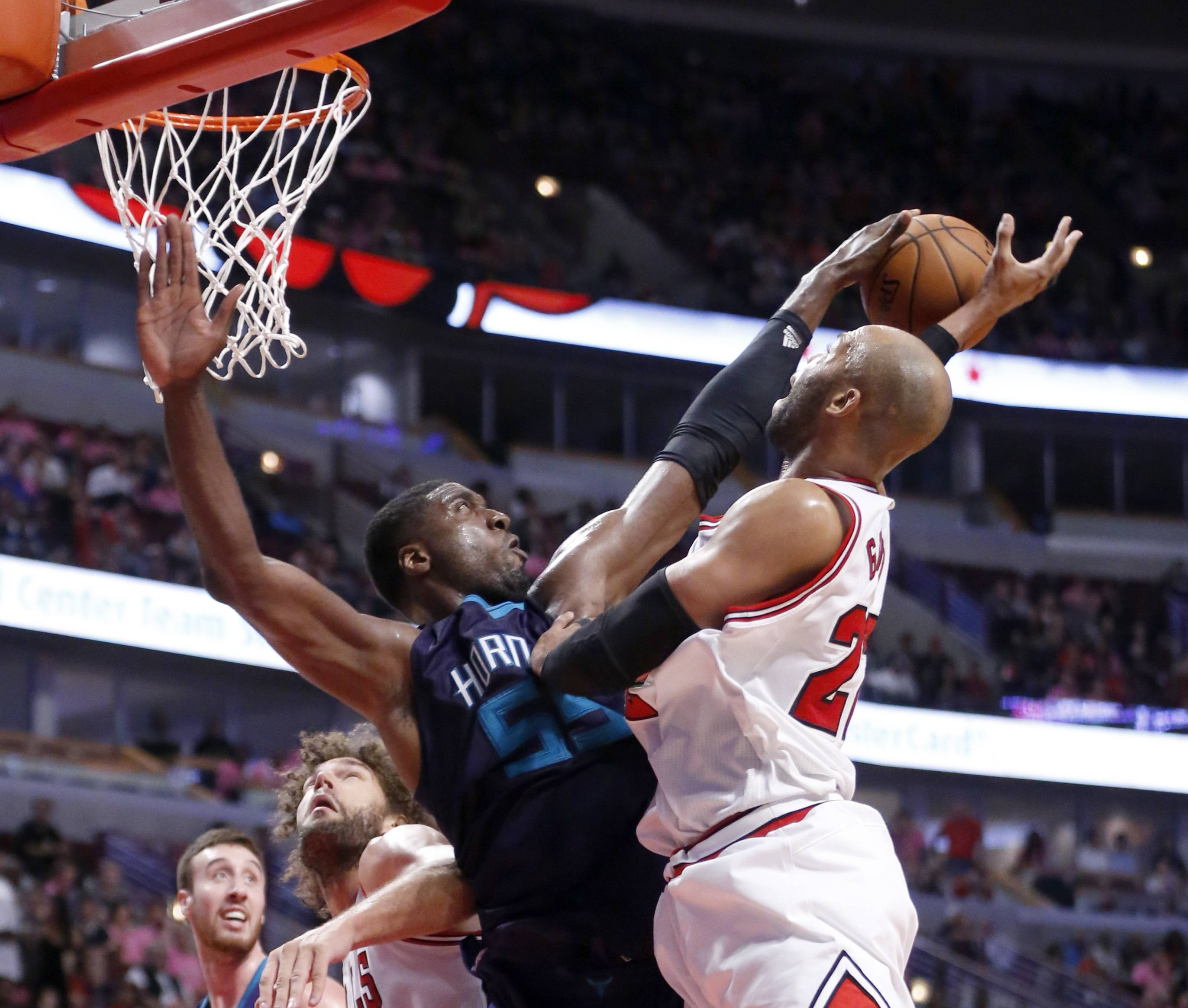 Charlotte Hornets' Roy Hibbert, left, blocks the shot of Chicago Bulls power forward Taj Gibson during a preseason game on Oct. 17, Gibson will start for the Bulls when they open their NBA season on Thursday.