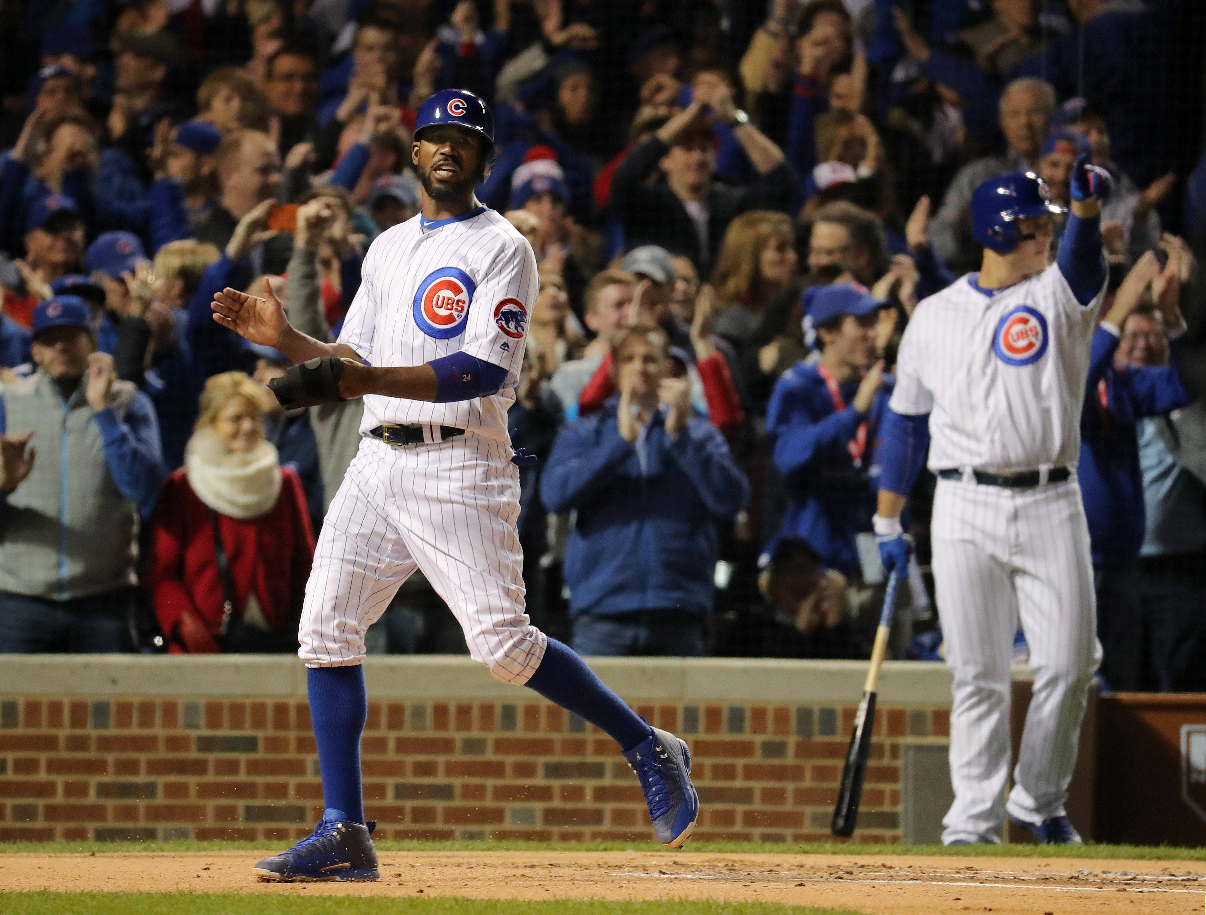 Chicago Cubs center fielder Dexter Fowler scores against the Los Angeles Dodgers in Game 6 of the National League championship series at Wrigley Field in Chicago.