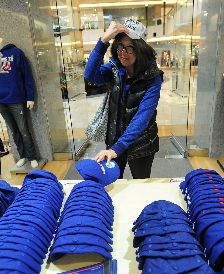 Riverwoods resident Bonnie Sloan shops for Cubs merchandise at Clark Street Sports at Northbrook Court. She managed to grab one of the popular gray World Series hats.