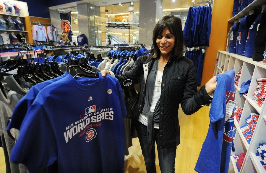 Amy Hertzberg of Northbrook looks for Cubs merchandise at Clark Street Sports at Northbrook Court Tuesday.