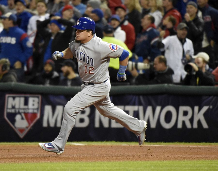 Chicago Cub Kyle Schwarber (12) legs out a double in the fourth inning during Game 1 of the Major League Baseball World Series between the Cleveland Indians and the Chicago Cubs Tuesday, Oct. 25, 2016, in Cleveland.
