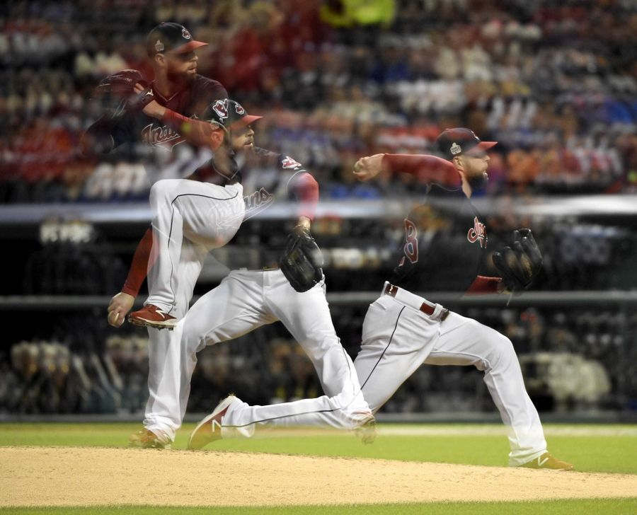 Indians hurler Cory Kluber delivers in this multiple exposure image during Game 1 of the Major League Baseball World Series between the Cleveland Indians and the Chicago Cubs Tuesday, Oct. 25, 2016, in Cleveland.