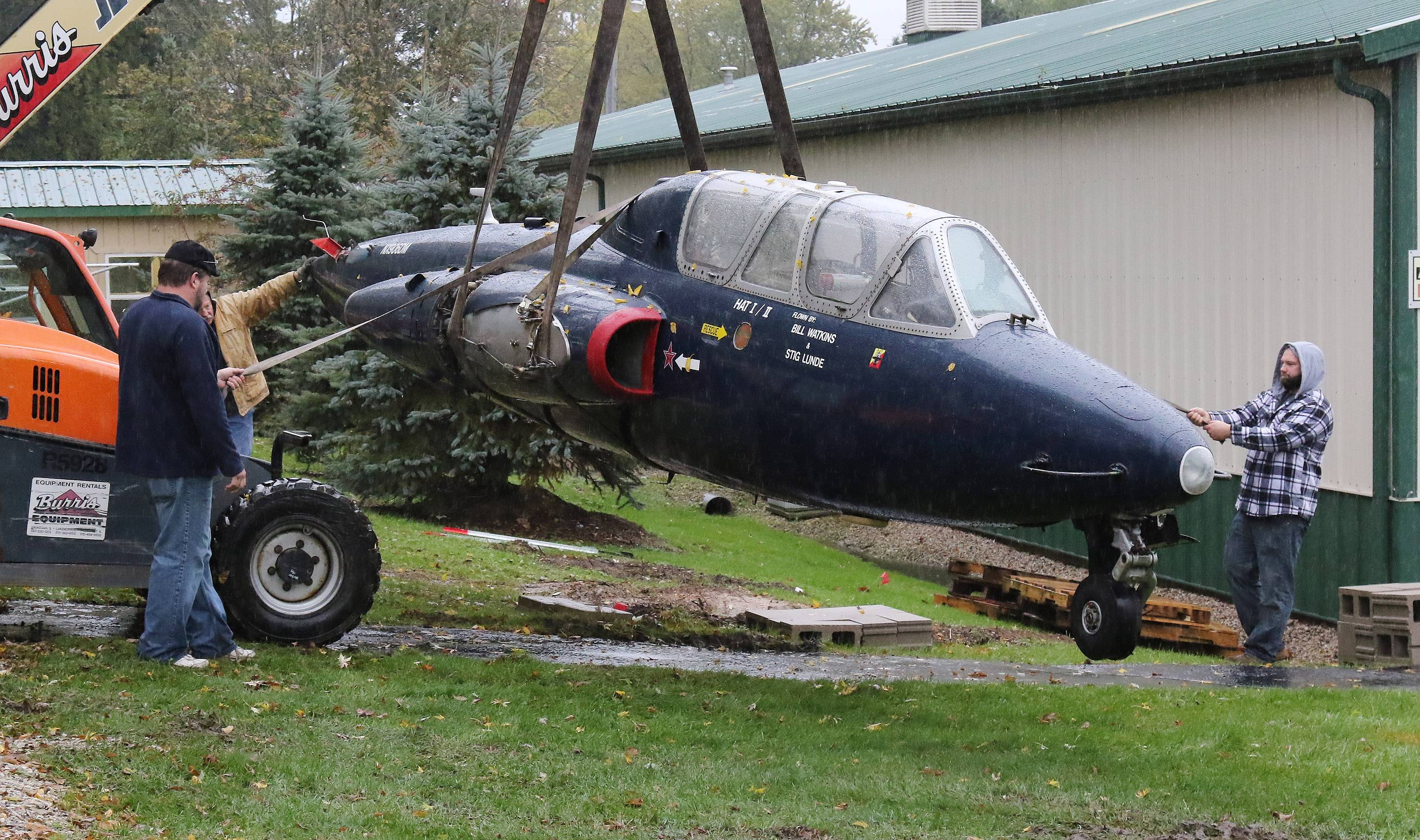 A work crew moves a French military trainer jet, the Fouga CM-170 Magister, in to place at the Volo Auto Museum on Wednesday. The jet was built in the 1950s and donated by a woman from Texas.
