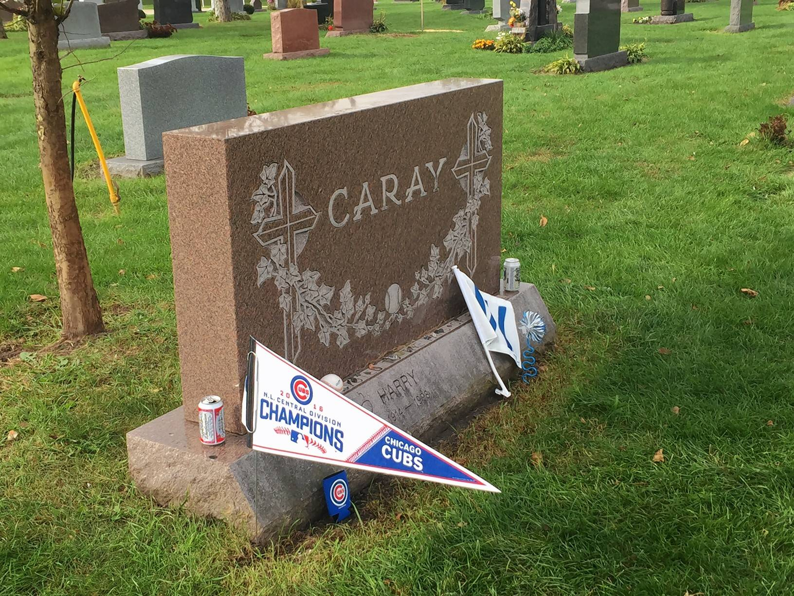 Fans toasting Cubs at Harry Caray's grave in Des Plaines
