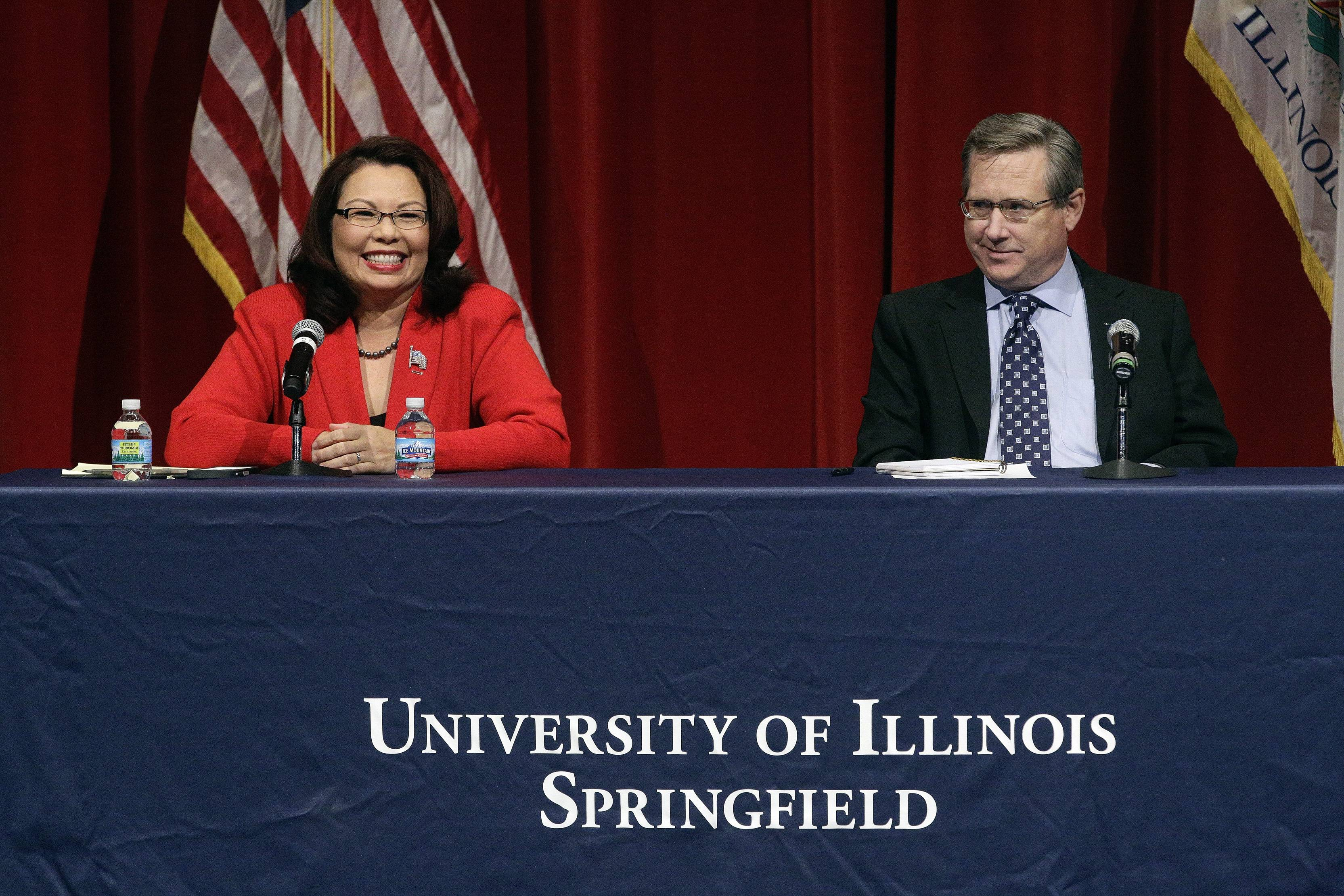 Republican U.S. Sen. Mark Kirk, right, and Democratic U.S. Rep. Tammy Duckworth, left, face off in their first televised debate in what's considered a crucial race that could determine which party controls the Senate, Thursday, Oct. 27, 2016, at the University of Illinois in Springfield, Ill.