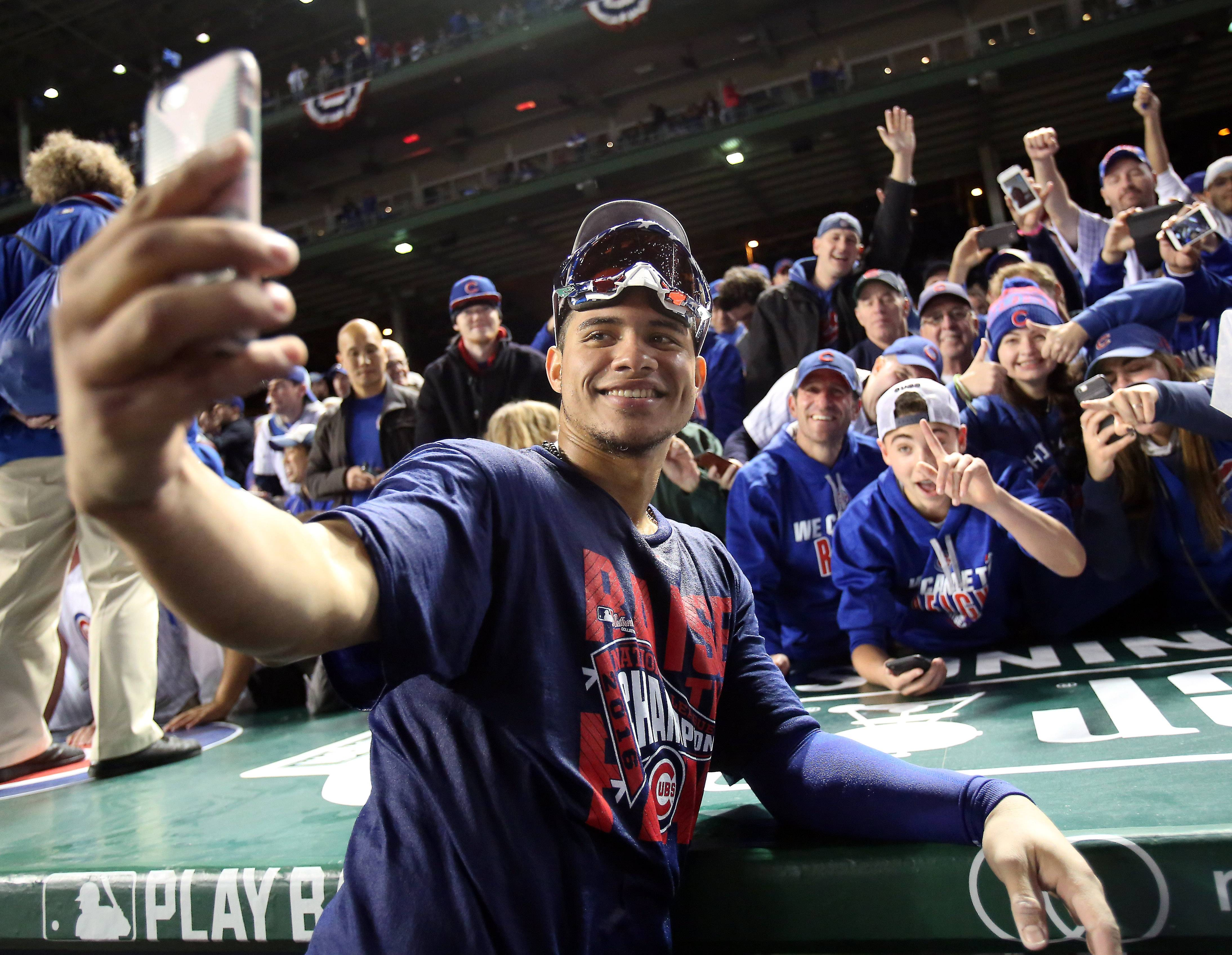 Cubs catcher Willson Contreras takes a selfie with the fans after Game 6 of baseball's National League championship series at Wrigley Field in Chicago.