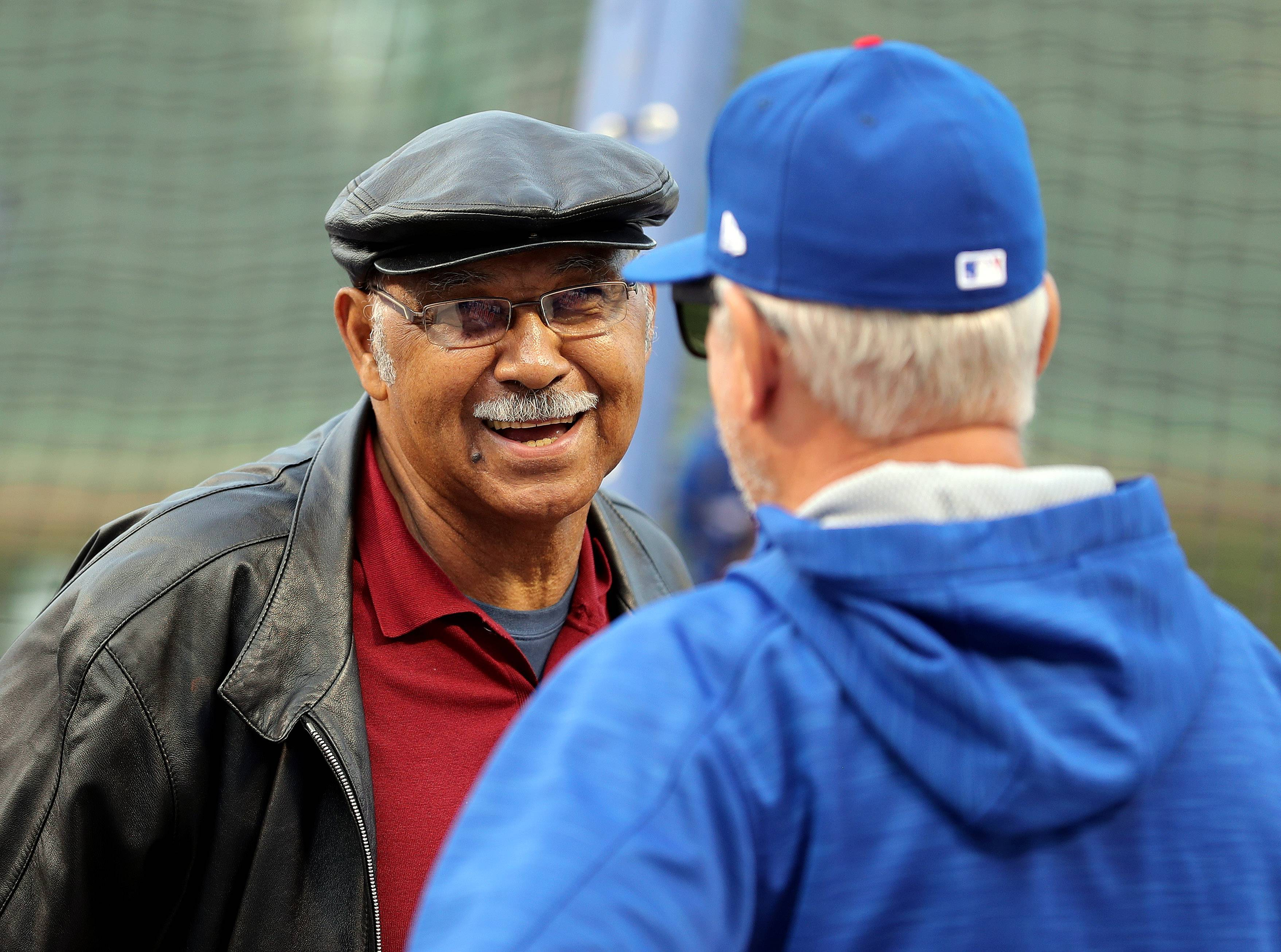 Former Cub Billy Williams, left, talks with Chicago Cubs manager Joe Maddon during game 1 of the National League championship series against the Los Angeles Dodgers at Wrigley Field in Chicago on Saturday, October, 15, 2016.