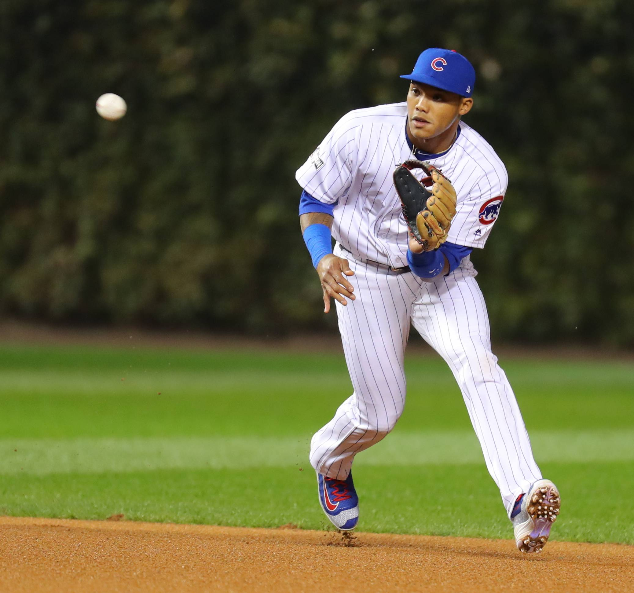 Steve Lundy/slundy@dailyherald.com Cubs shortstop Addison Russell field a ball during game one of the National League division series at Wrigley Field in early October. Russell is one of four Cubs who are Gold Gloves finalists.