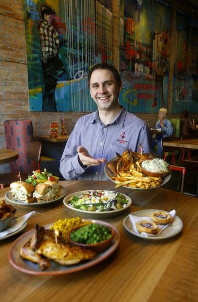 Nando S Peri General Manager Justin Kipp Shows Off The En Dishes At Chain
